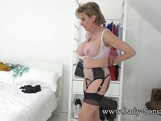 Lady Sonia teasing you close to her big boobs