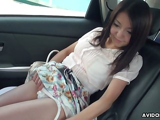 Flavourful Japanese chick Mami Sugiyama is masturbating in the back seat