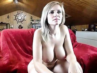 Busty blonde Kayden Kross strips extensively of sheer lingerie