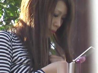 Japanese schoolgirl recorded by peculiar voyeur on a street