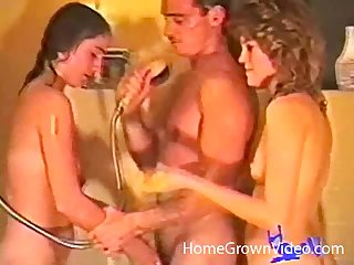 Retro video of a undesigned guy bonking his wife and the brush best friend