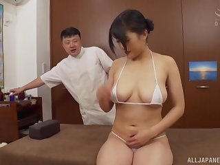 Busty Japanese model Sachiko opens her legs hither be fingered